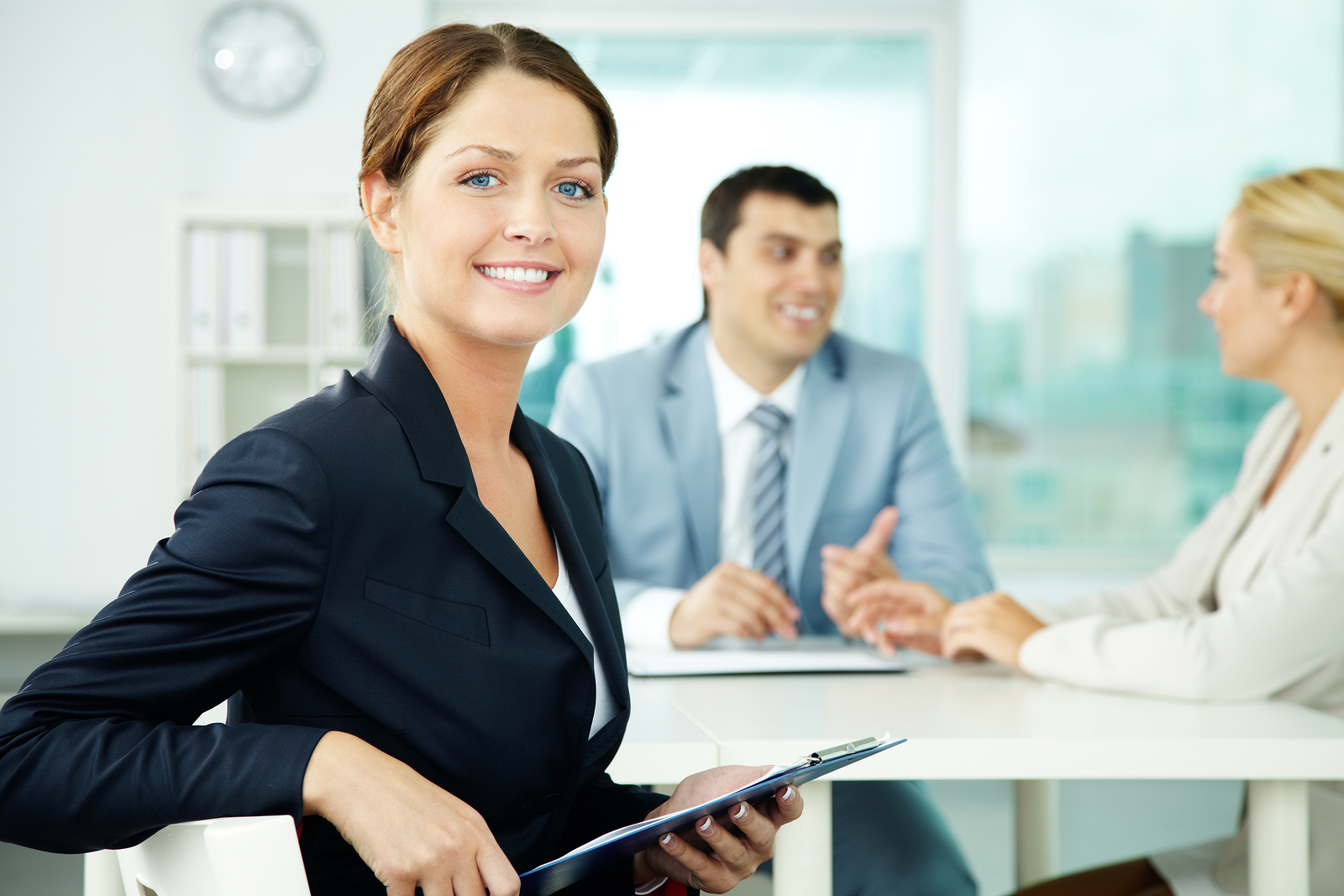 A beautiful businesswoman looking at camera in working environme
